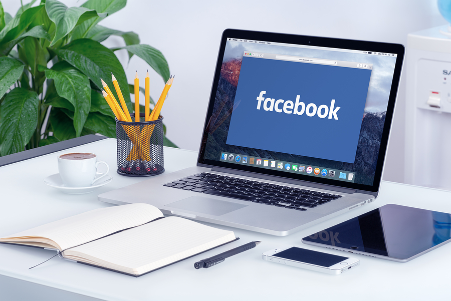 Facebook New Logo On The Apple Macbook Pro Screen That Is On Off