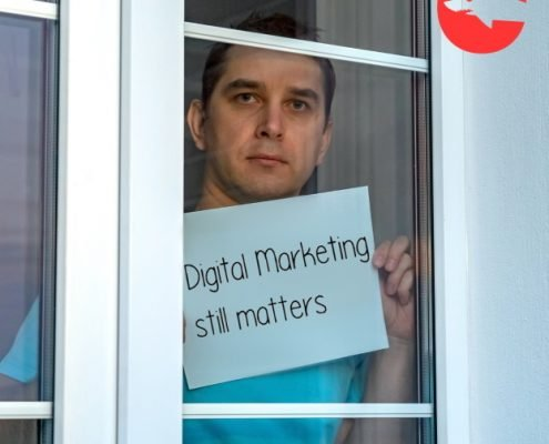 Man Self Isolating Holding Sign That Says Digital Marketing Still Matters
